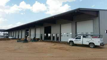 large commercial overhead garage door installation