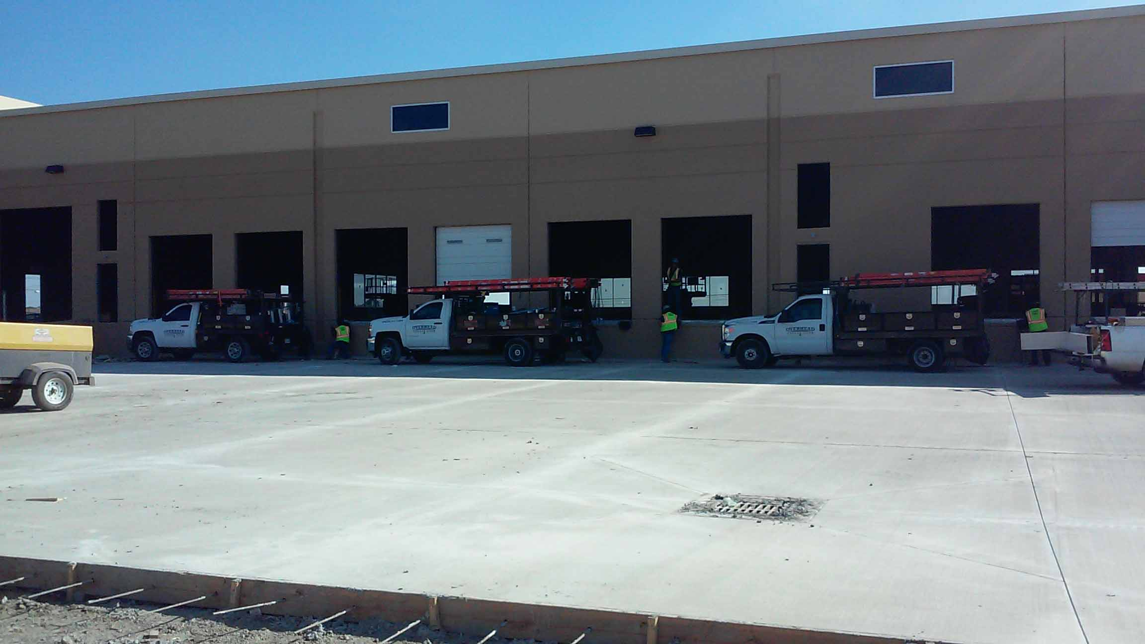 Commercial garage door installation Western Gate Quality Industries - Denton, TX - Completed 2015 - Contractor Links Construction