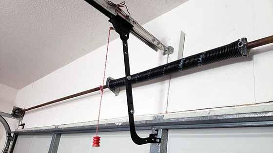 Lubbock Overhead Door Technician Repairing Garage Door Operator